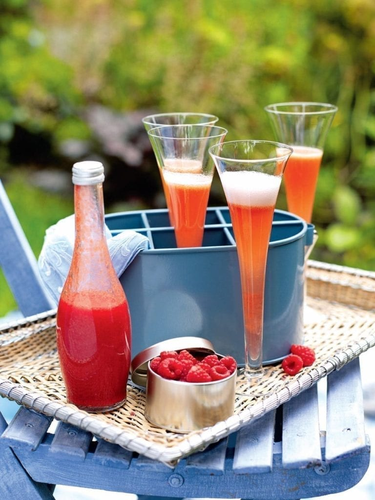 Peach and raspberry Champagne cocktail