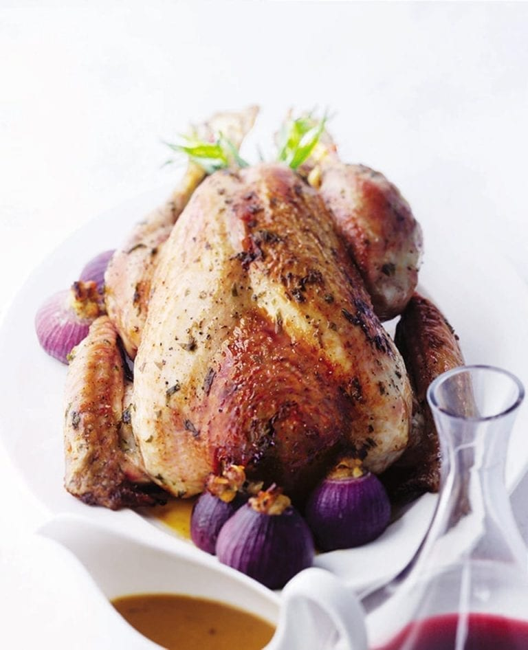 Roast turkey with stuffing-filled onions