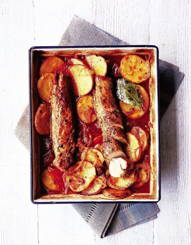 Juniper pork fillet with potatoes and smoked sausage