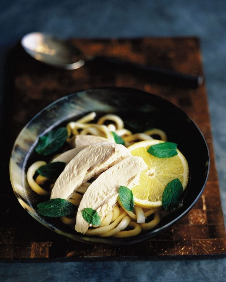 Chicken noodle soup with mint and lemon