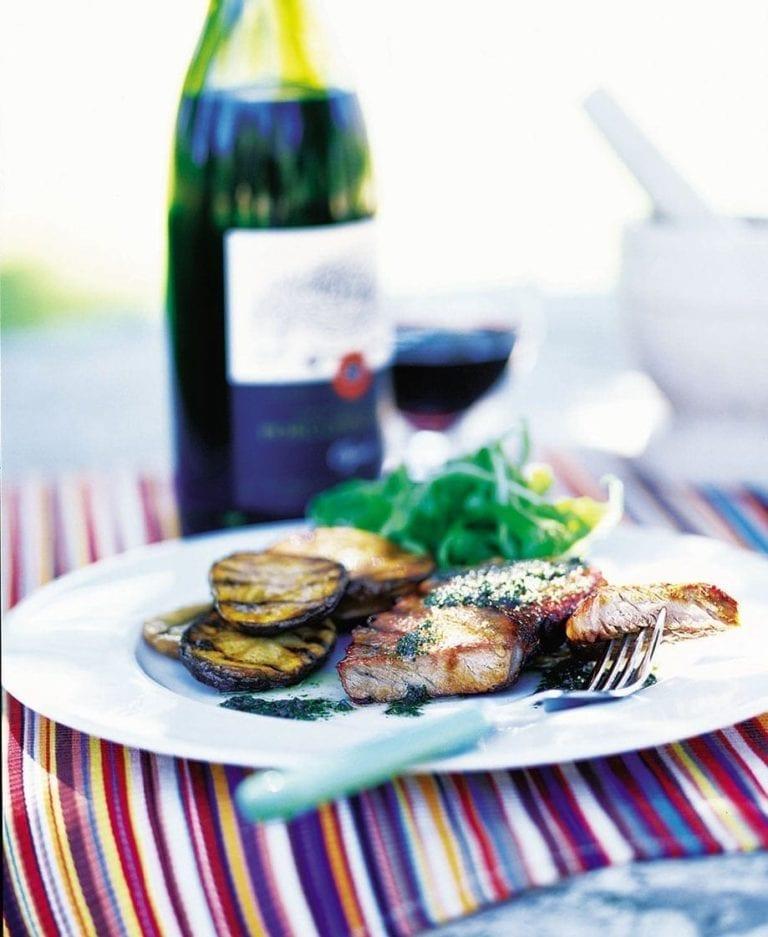 Seared steaks with fresh salmoriglio and potato slices