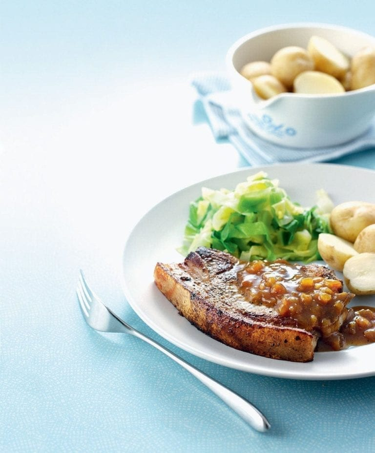 Pork chops with chutney sauce and greens