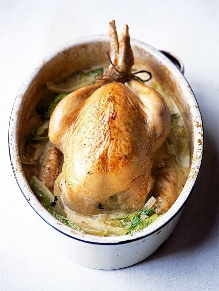 Pot-roast cider chicken with creamy onions and gem lettuce