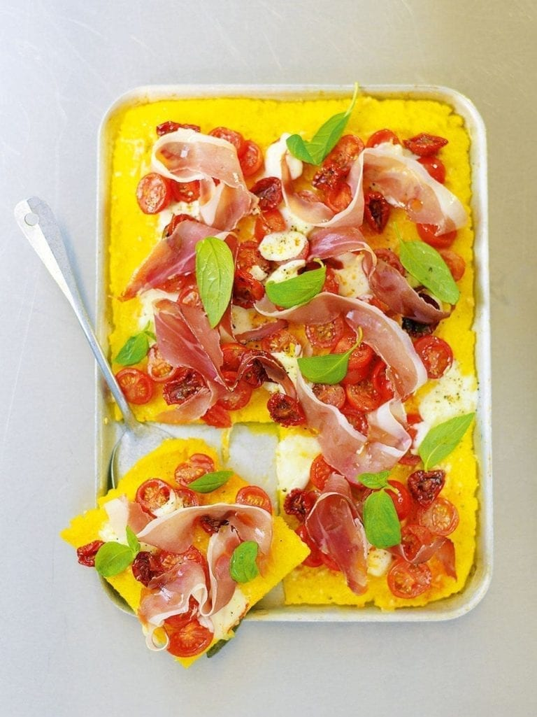 Polenta, tomato and prosciutto bake