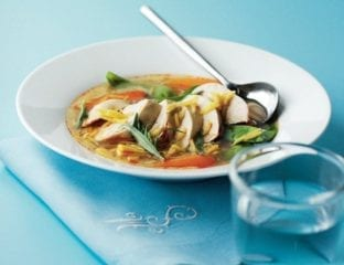 Poached chicken and rice broth