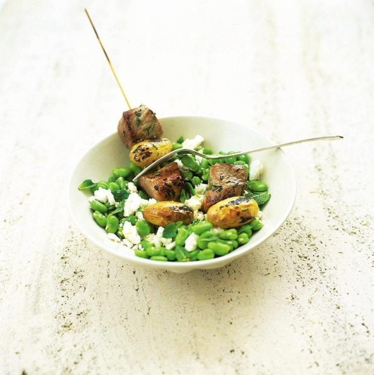 Pork kebabs on minted broad beans with feta