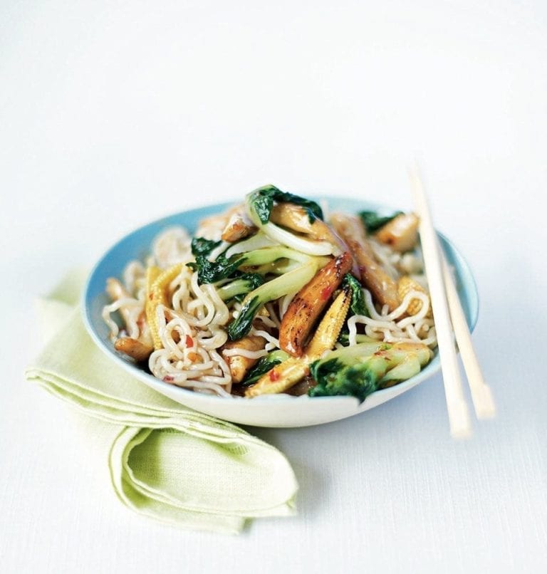 Stir-fried chicken and noodles in plum sauce