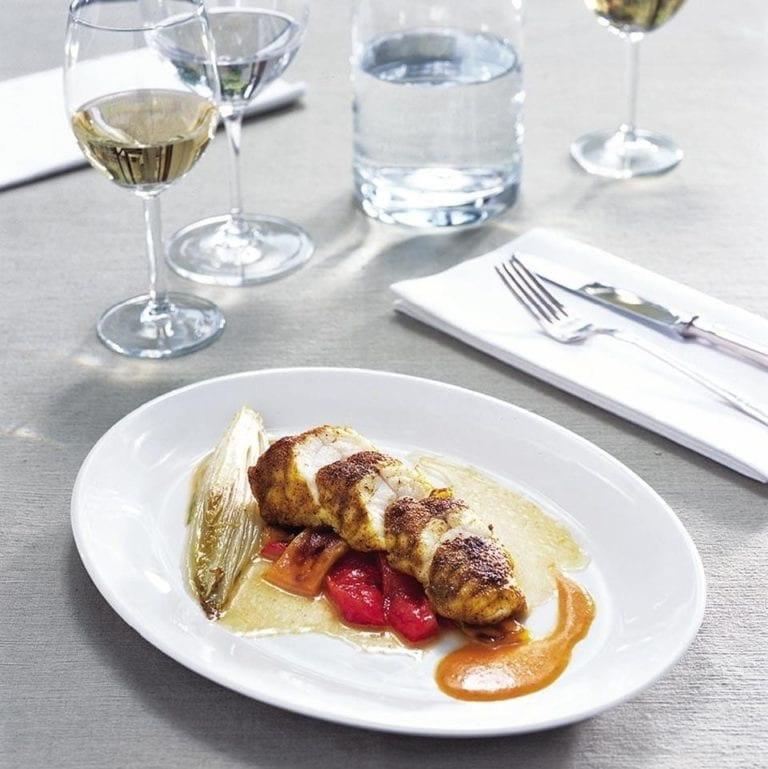 Spiced monkfish with chicory and orange butter sauce