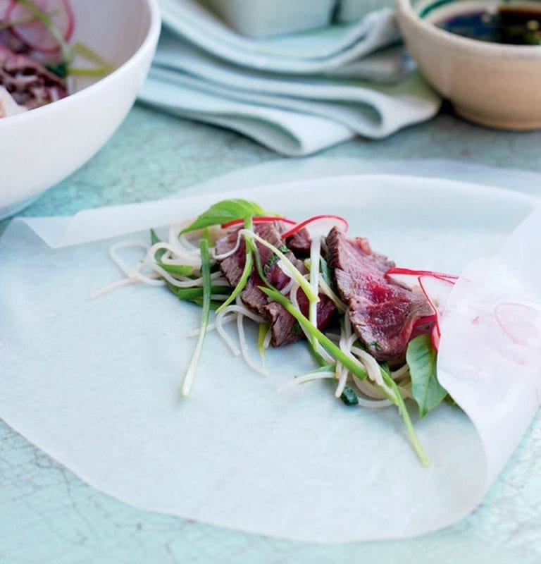 Vietnamese rolls with radishes and seared beef
