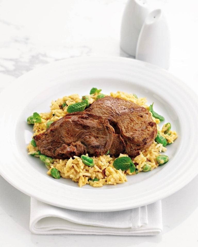 Cheat's spicy lamb steaks with coconut and broad bean rice