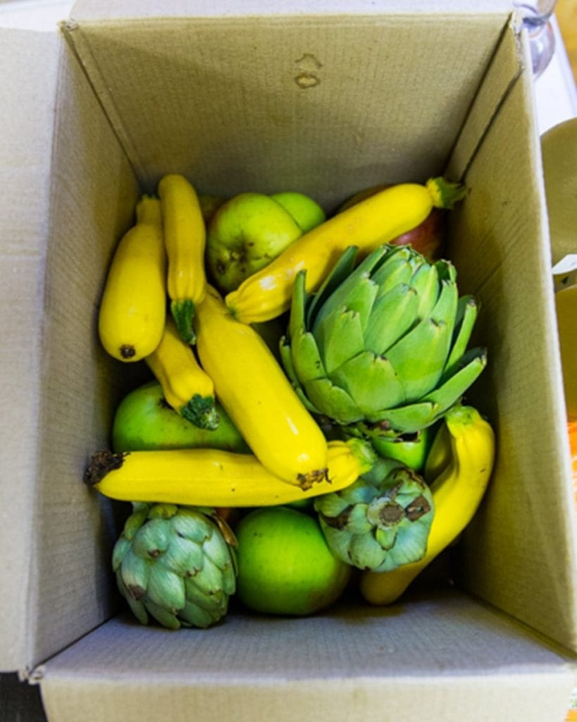 Courgettes and artichokes in a box