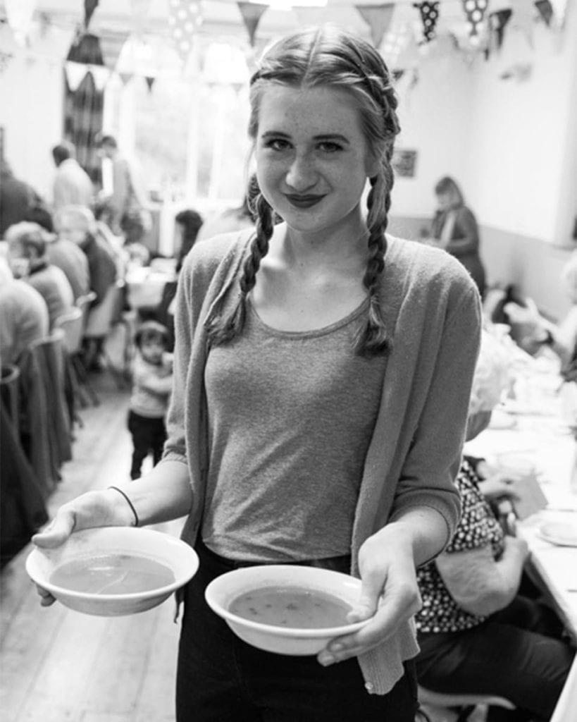Teenage girl with soups