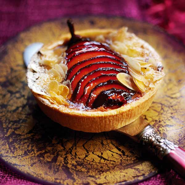 Chocolate tarts with mulled pears