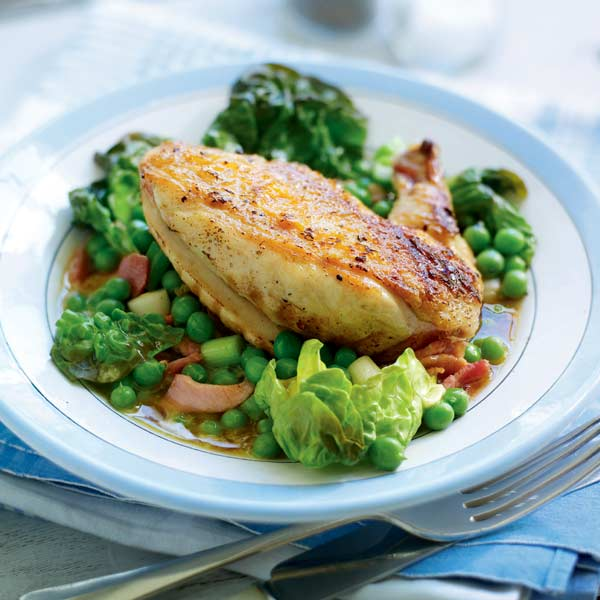 Pan-fried chicken with peas, bacon and lettuce