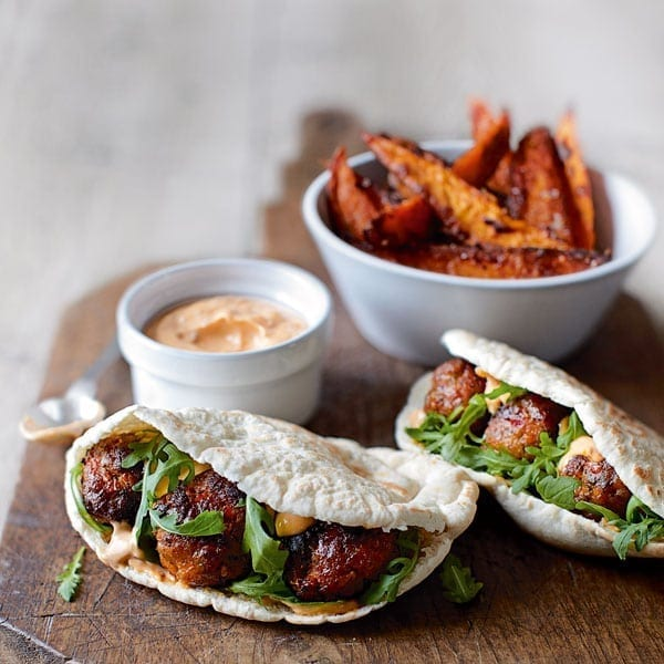 Spicy pork meatball pittas with harissa mayo and sweet potatoes
