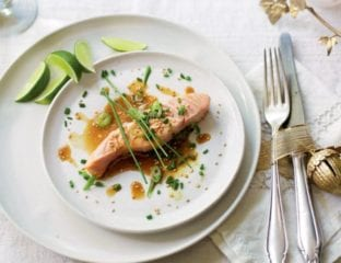 Poached salmon with soy, lime, spring onion and sesame seeds