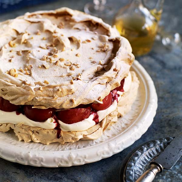 Hazelnut meringue cake with mulled wine pears