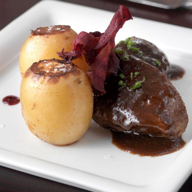 Braised pork cheeks with confit potatoes