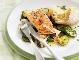 Pan-fried salmon with herby courgettes