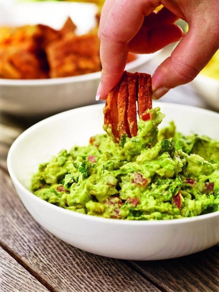 Pork scratchings with zingy guacamole