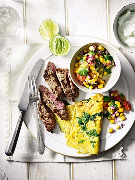 Spiced lamb with coriander omelette and sweetcorn salsa
