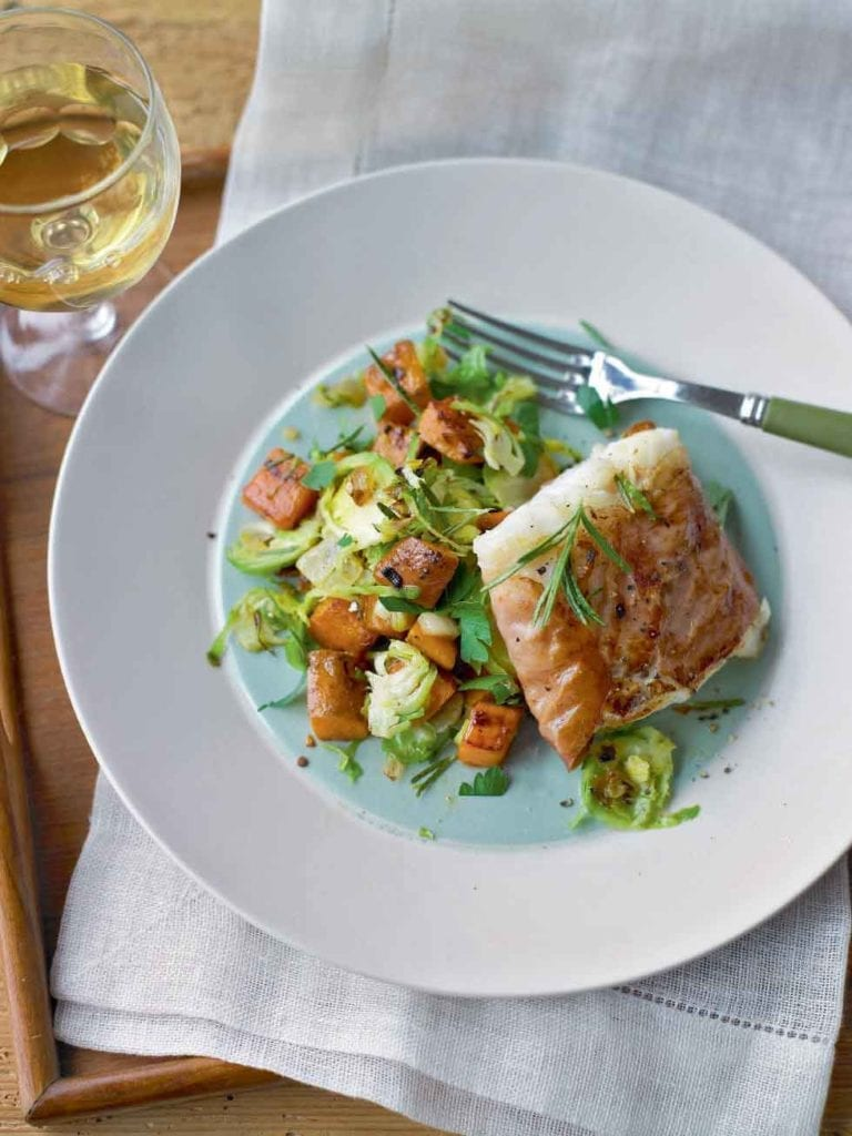 Parma ham-wrapped fish with sprout and sweet potato hash