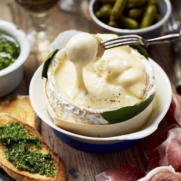 Baked cheese with herb pesto