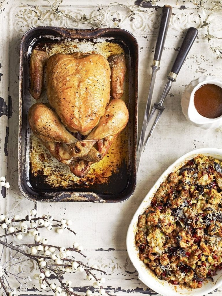 Roast chicken with sausage, chard and parmesan stuffing