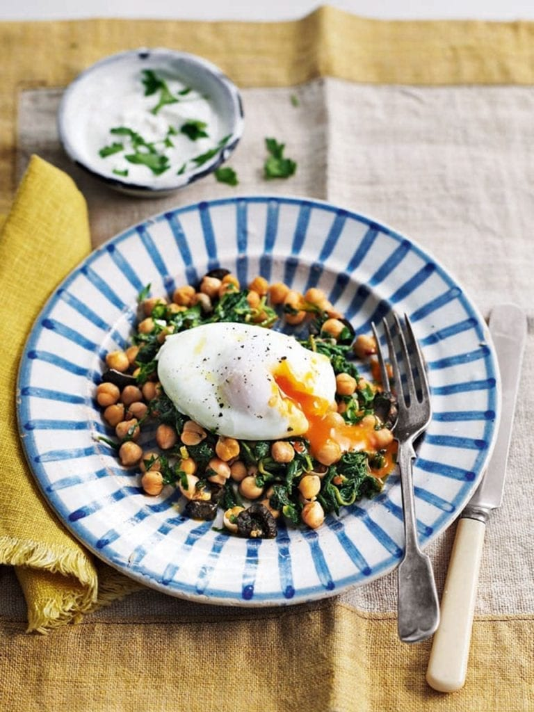 Poached eggs with harissa chickpeas and garlic yogurt