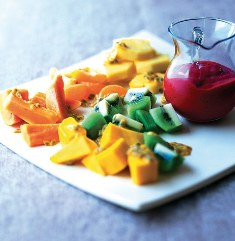 Tropical fruit salad with raspberry and orange sauce