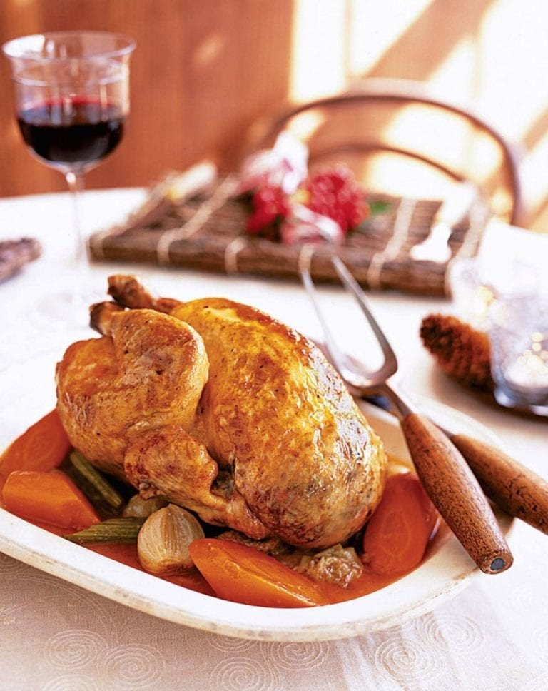 Pot-roast guinea fowl with pistachio stuffing