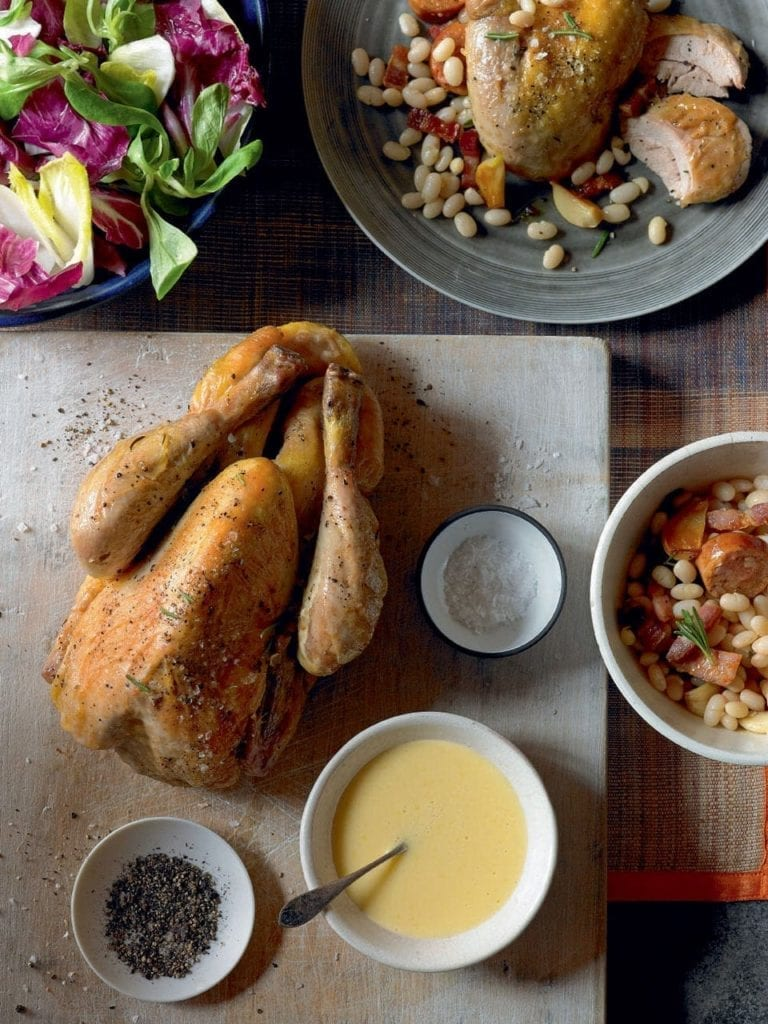 Baked guinea fowl with garlic beans and smoked sausage
