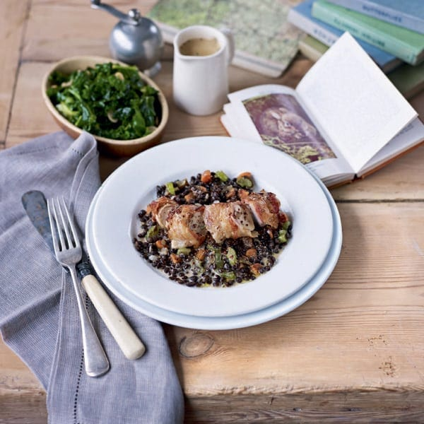 Rabbit loins wrapped with pancetta on braised puy lentils