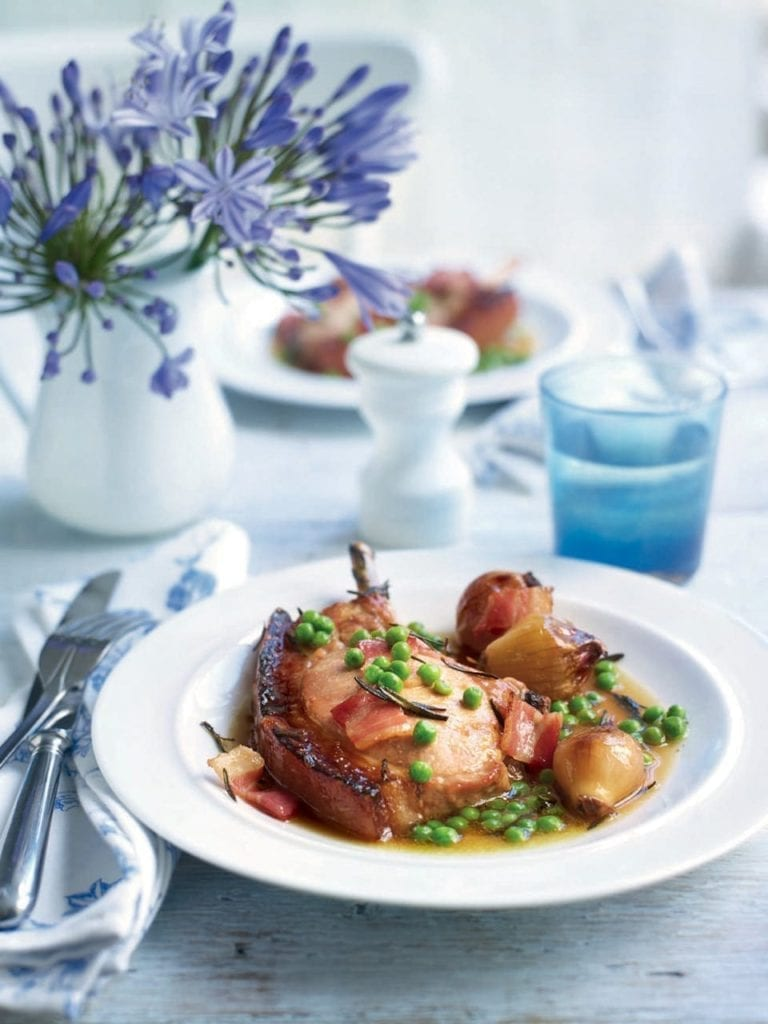 Pot-roasted pork chops in cider with shallots and peas