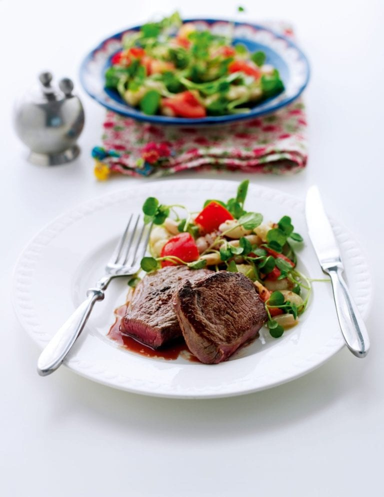 Seared steak with white beans and watercress