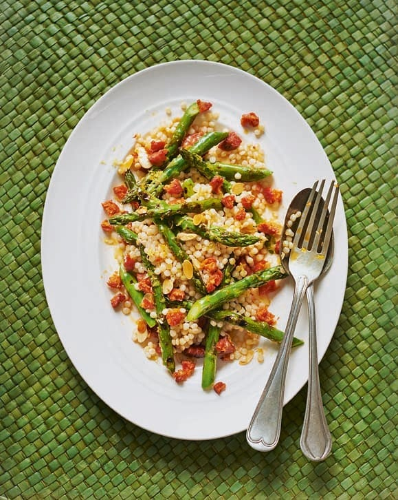 Warm salad of asparagus, giant couscous and chorizo