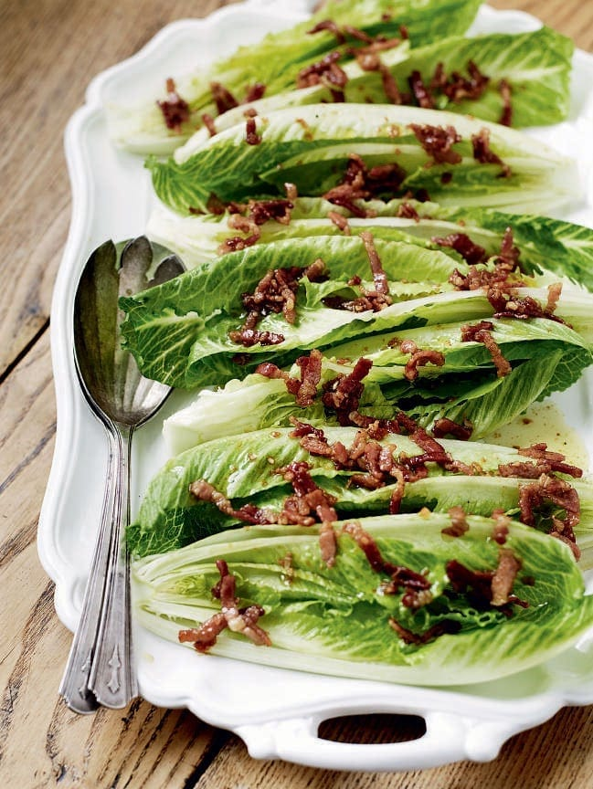 Crisp lettuce hearts with a hot bacon, maple syrup and garlic dressing