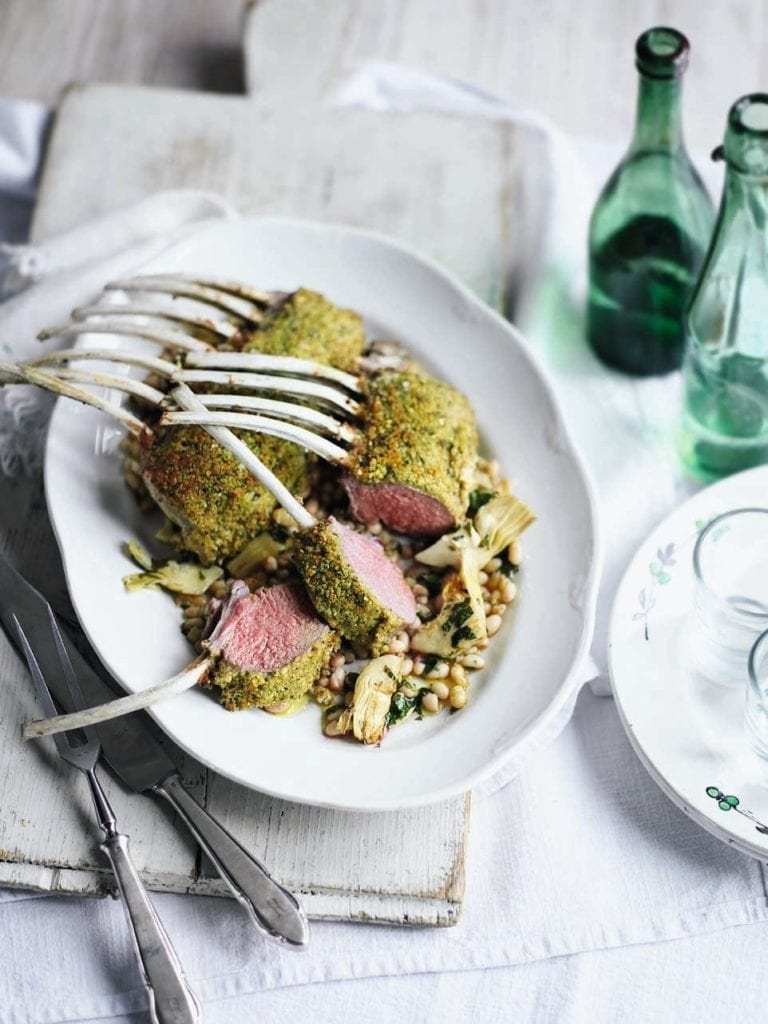 Herb-crusted rack of lamb with beans, artichokes and garlic