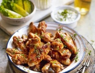 Buffalo chicken wings with celery sticks and blue cheese dip