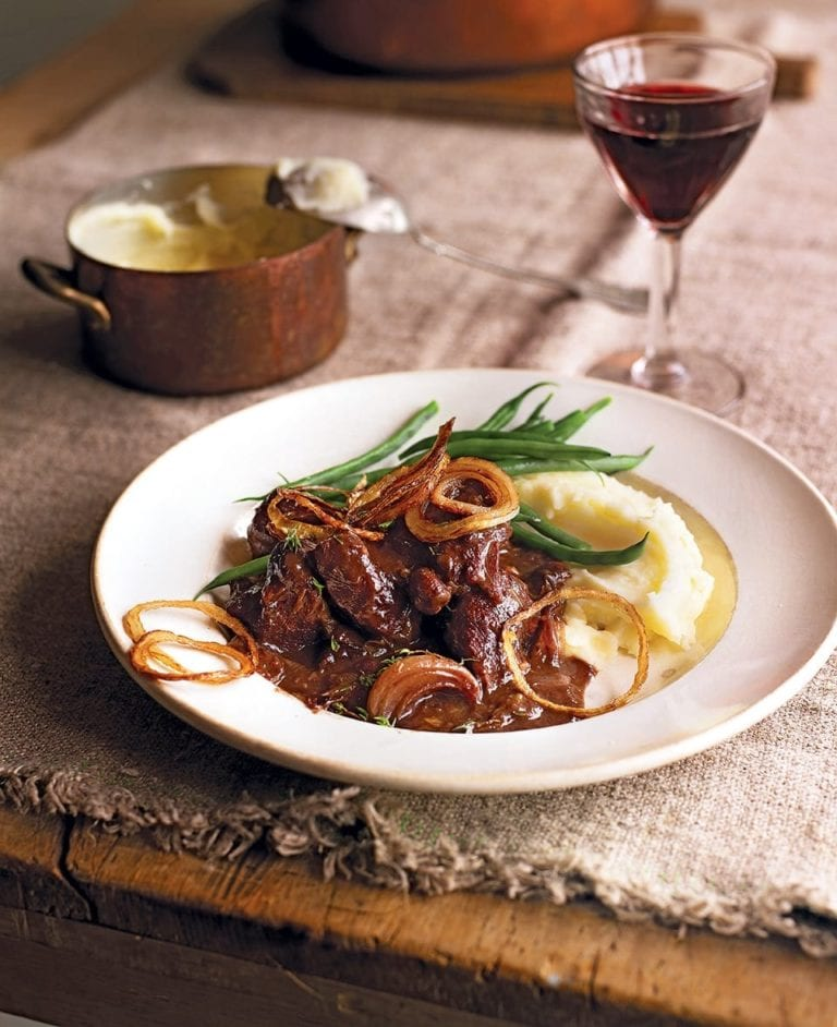 Braised venison with prunes, port and crispy onions
