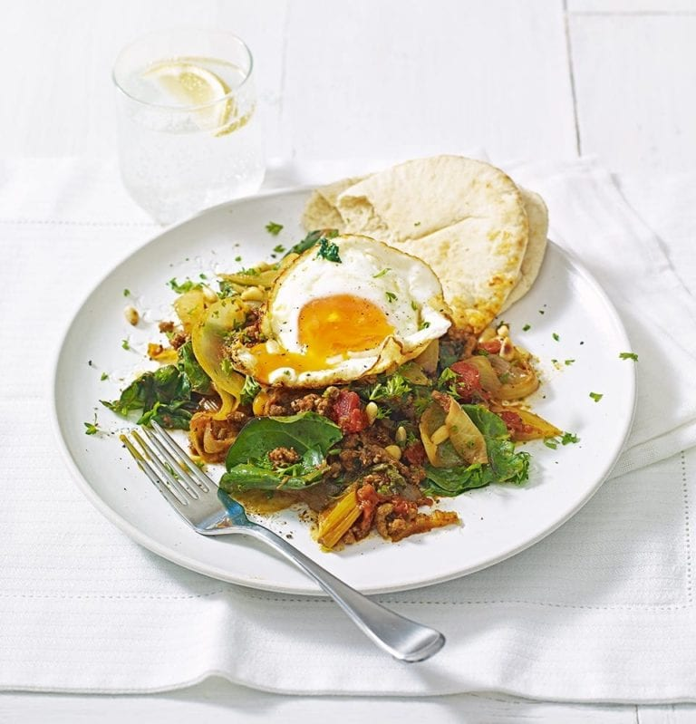 Spiced lamb mince with onions, chard and fried eggs