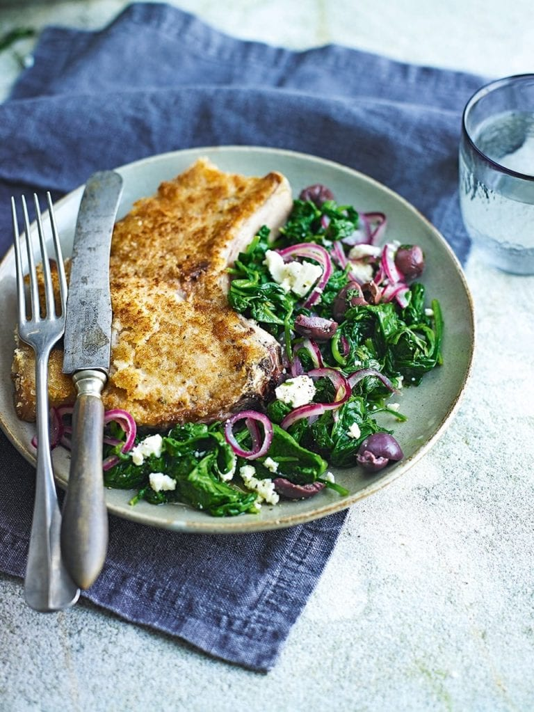 Wilted spinach with crumbed pork cutlets