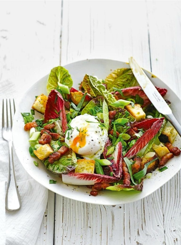 Bistro salad with poached egg, croutons, lardons and walnuts