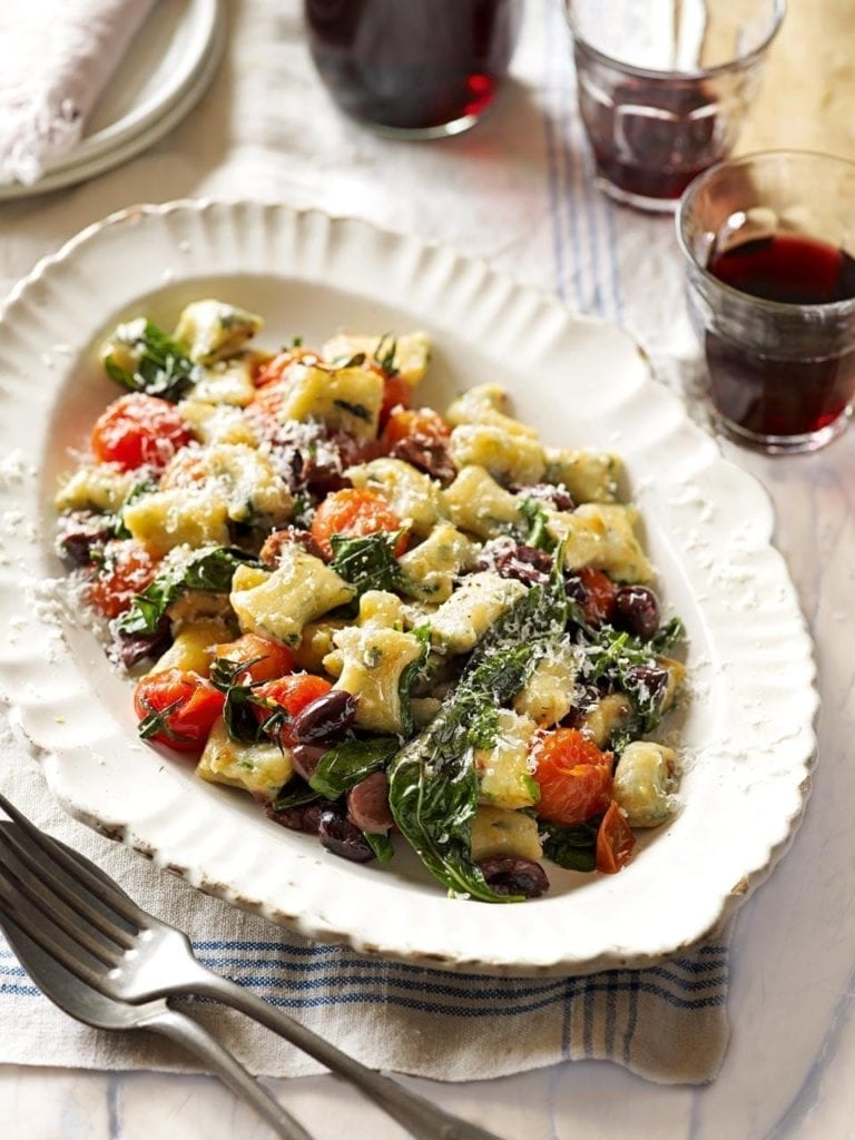 Spinach gnocchi with blistered tomatoes, basil and olives