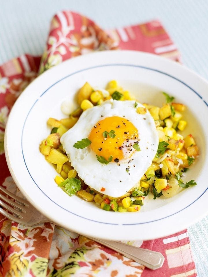 Sweetcorn, courgette and potato hash with fried egg