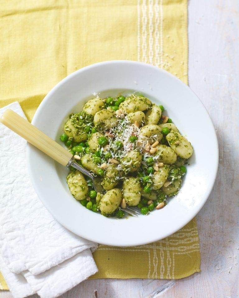 Pesto gnocchi with peas and pine nuts