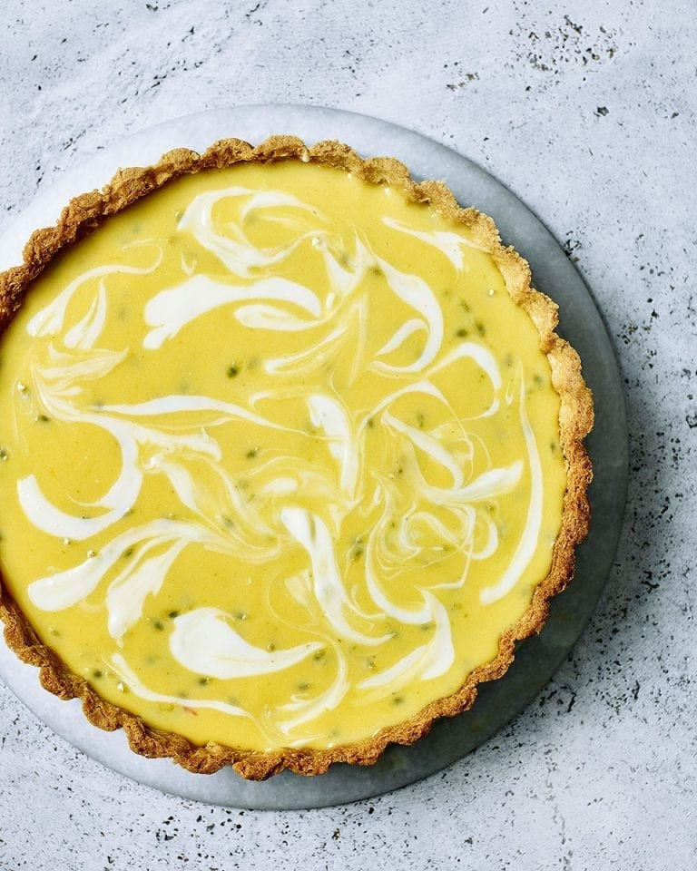 Lemon, lime and passion fruit cheesecake tart | delicious. magazine