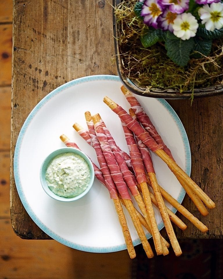 Parma ham-wrapped grissini with pesto dip
