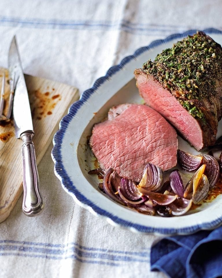 Slow-roast beef with a pepper and rosemary crust and onions