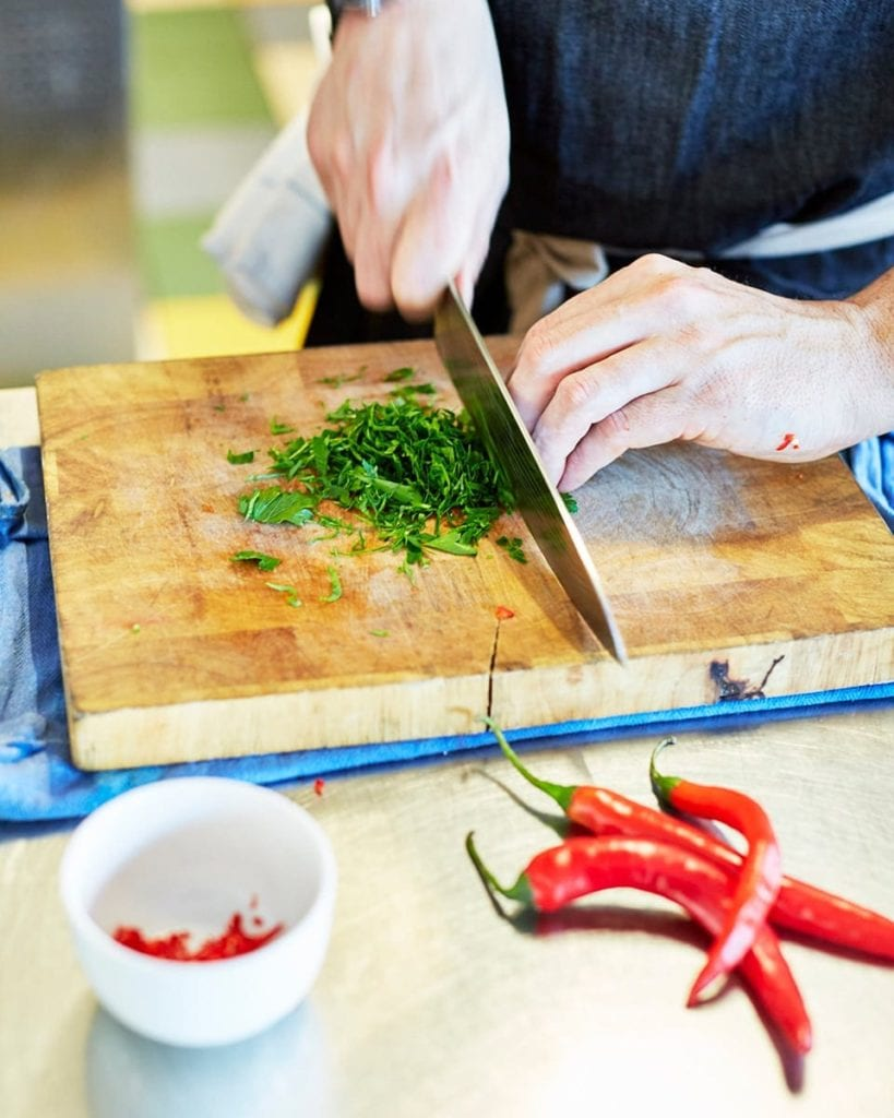 Image of herbs being chopped